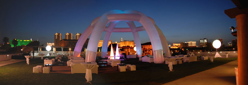 Sculptural white LED balloon lighting float above Somers Furniture event rental at Alexis Park in Las Vegas.