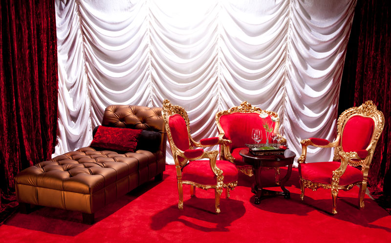 Metallic copper chaise, ornate baroque chairs, white cascade draperies backdrop, traditional cherry cocktail table add to the romantic vibe for this bachelorette party