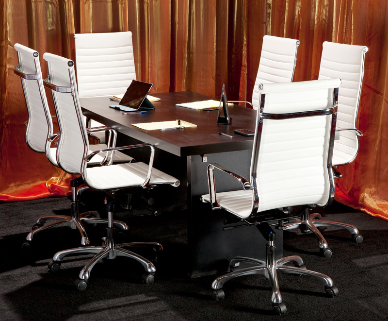 Executive seating with white leather high back chairs that feature a swivel tilt mechanism and a black conference table
