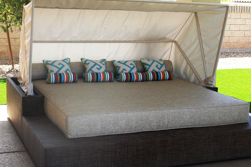 luxurious poolside bed with canopy