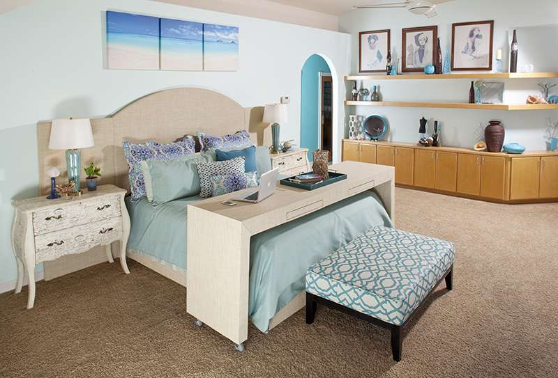 Natural outdoor rattan-look fabric wrapped headboard and desk with water decor for tropical feeling bedroom