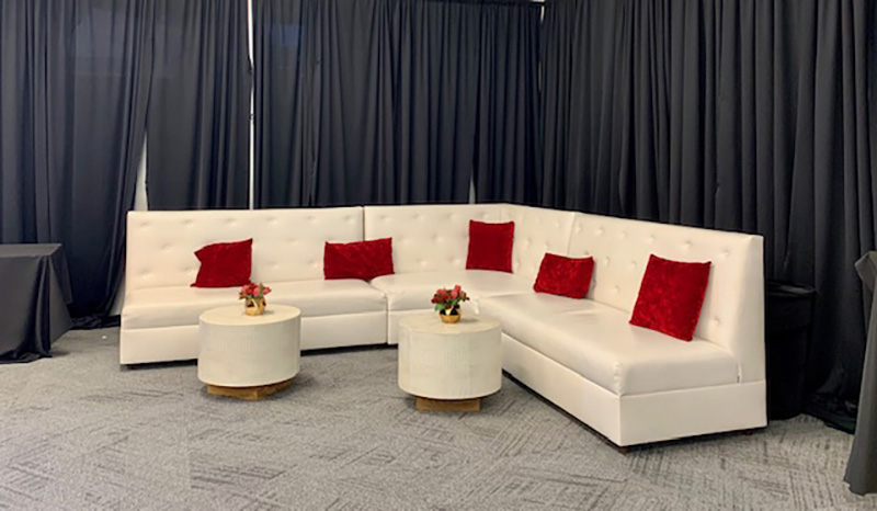 Somers furniture rental supplied white high back curved sectional with accent tables for grand opening party in las vegas