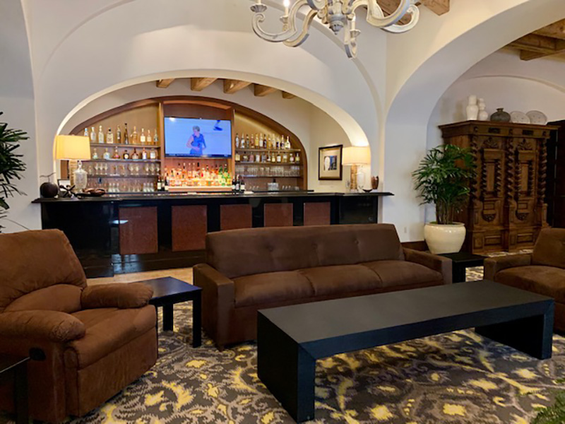 oversized sofas, able to seat four men comfortably with big cocktail tables, end tables and recliners in luxury mansion for sports viewing party by somers rental furniture in las vegas