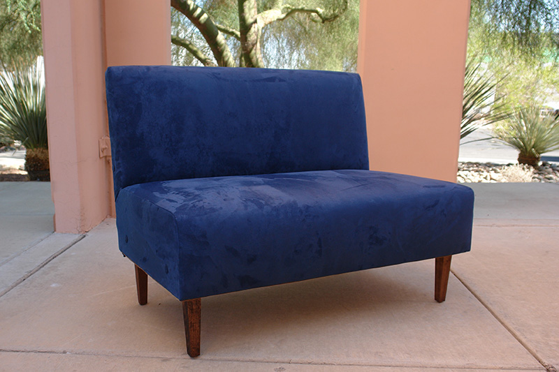 blue suede armless loveseat outdoors