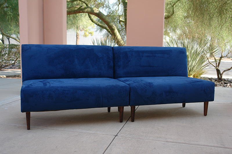 blue suede armless sofa outside