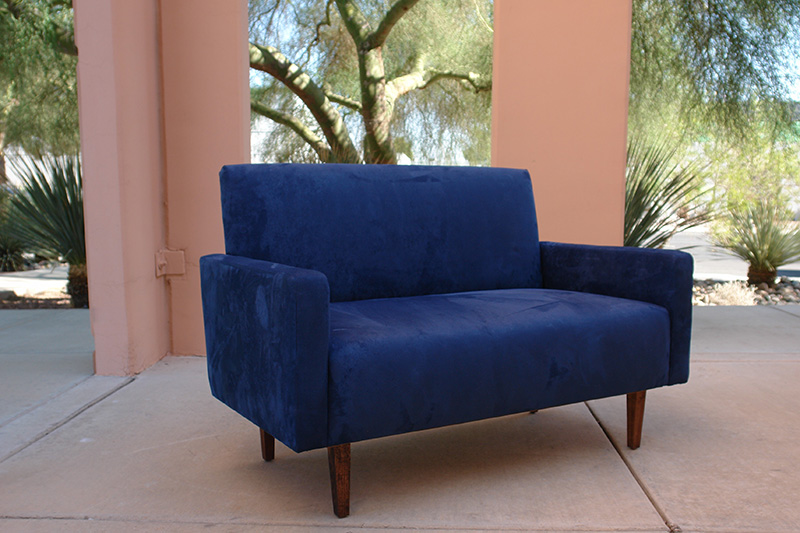 blue suede loveseat outdoors