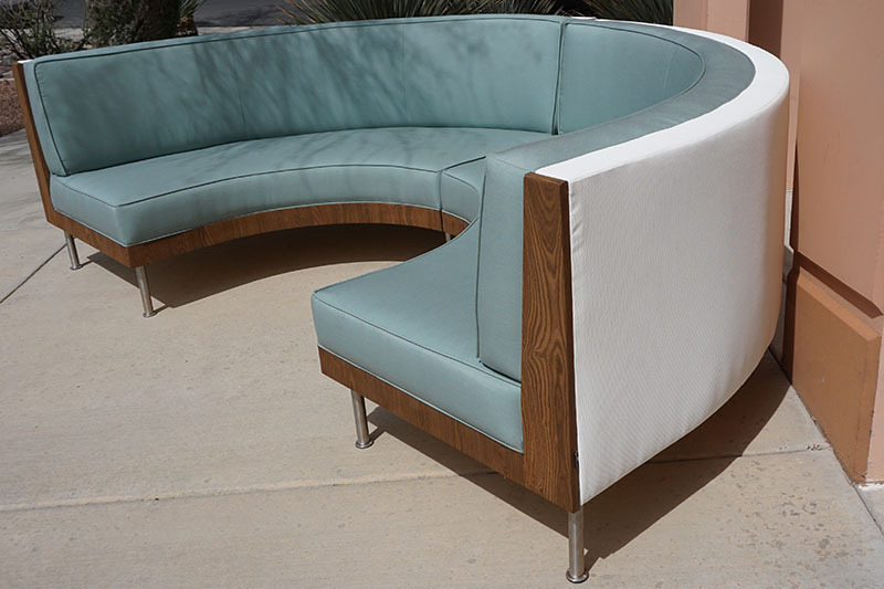 custom half round sofa in seafoam Sunbrella canvas and Thermory Pine sides and white vinyl back
