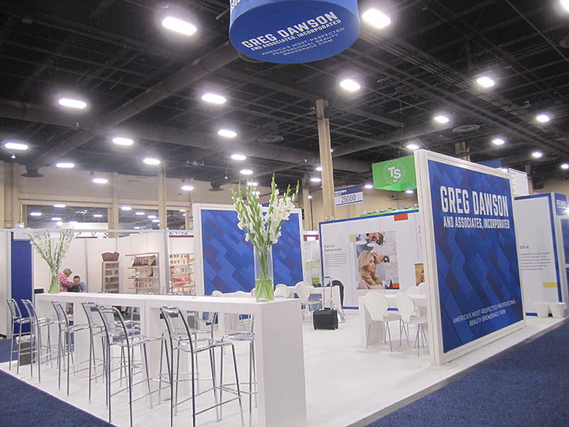white seating and tables for exhibit booth in las vegas by somers furniture rental in las vegas