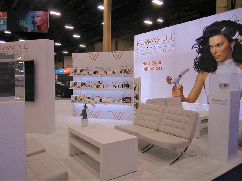 cosmoprof convention booth with white seating and tables from somers rental furniture in las vegas