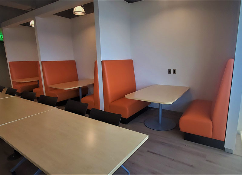 Orange dining booths in Las Vegas based office cafeteria