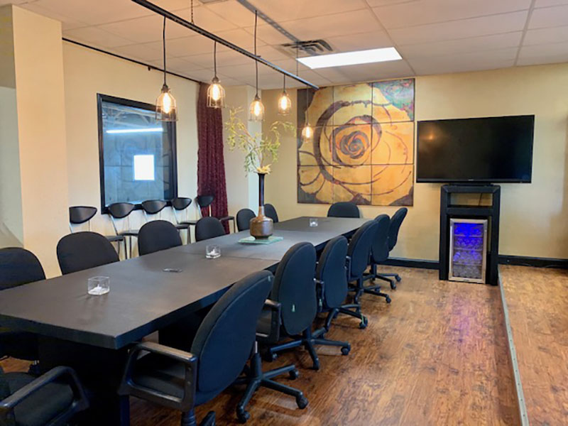 "Office conference room with custom 15"" conference table and custom TV cabinet by Somers Furniture"