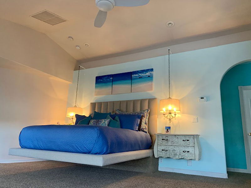 Custom floating California King bed and padded headboard for beach themed bedroom by Somers Furniture