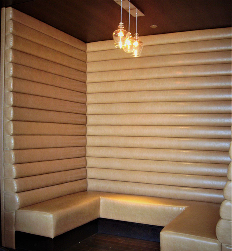 Gold metallic high back horizontal channelled booths used for high end dining at M Resort