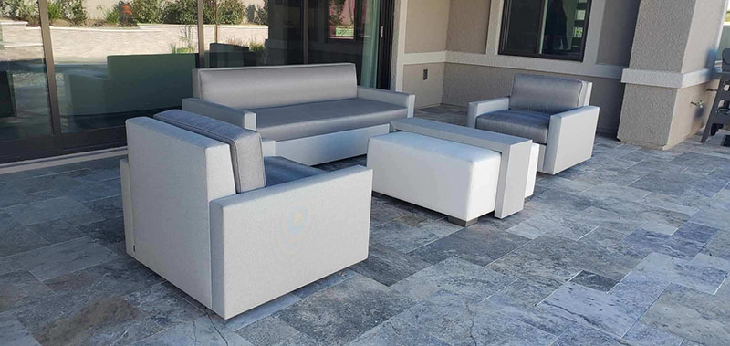 tight seated sofas and chairs with arms around ottoman cocktail  table on  backyard patio in las vegas