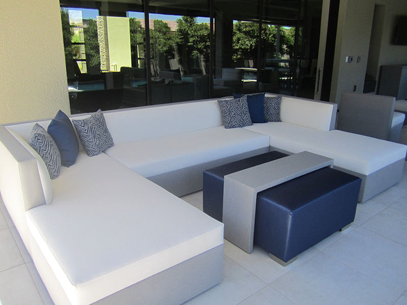 tight seated armless sofa sectionals with throw pillows in u-shape around ottoman cocktail table on private las vegas backyard patio