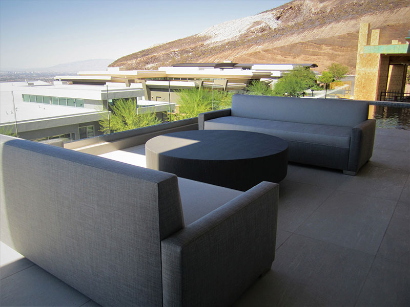 tight seated sofa with Ottoman cocktail table in las vegas private patio