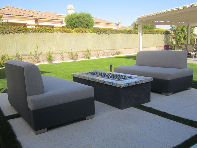 tight seated armless sofas by firepit in las vegas backyard