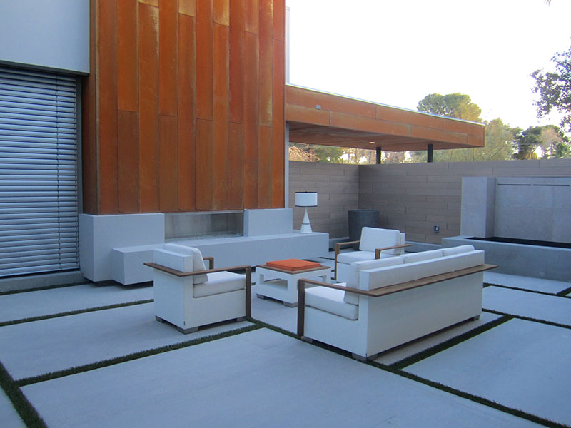 White Phifertex outdoor fabric wrapped around wood treated frames with Rain water proof fabric cushions to keep water off cushions and accented with Thermory Ash that weathers to gray on your built in drink rail.