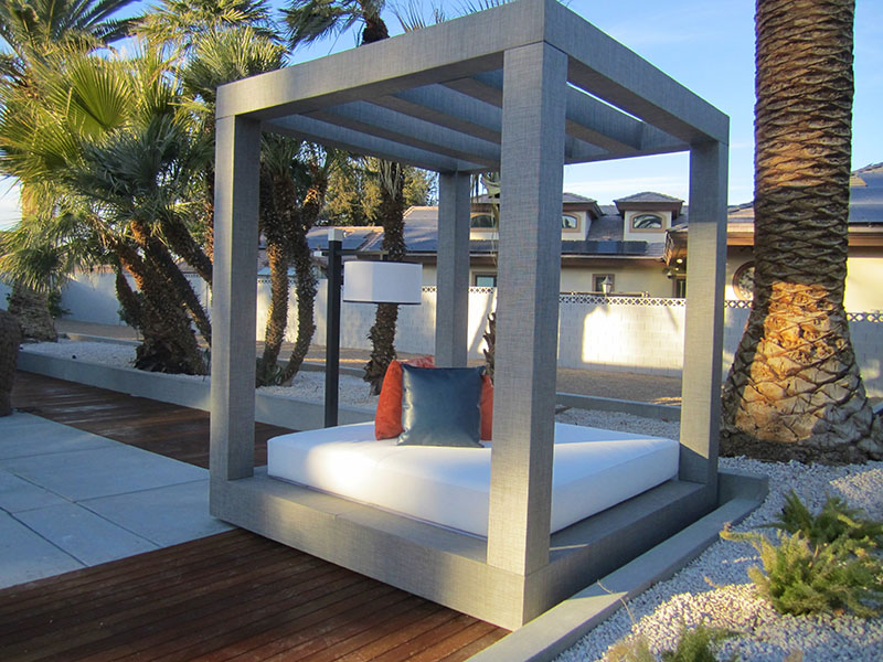Canopied daybeds gray outdoor Sunbrella fabric wrapped with wood treated bases shade by a backyard pool