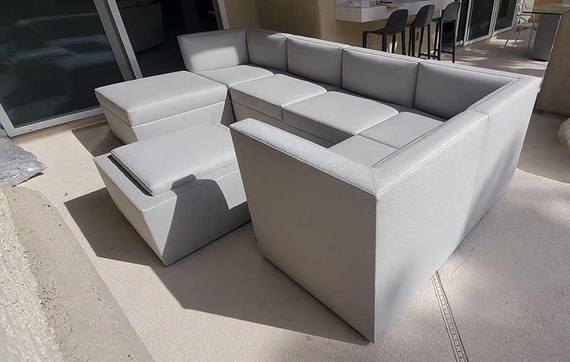 custom grey contemporary modular pieces making up a seating section with corner and modular chairs on outdoor patio
