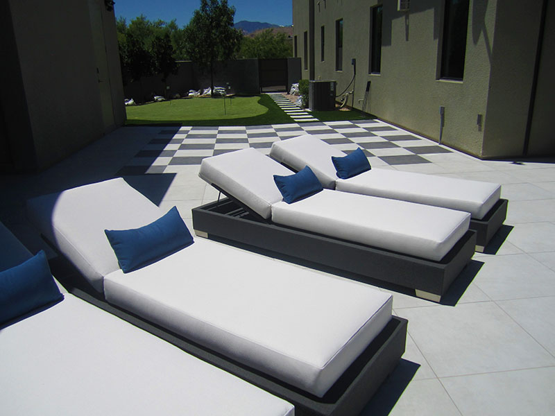 Custom flat adjustable loungers with blue lumbar pillows outside a luxury las vegas home
