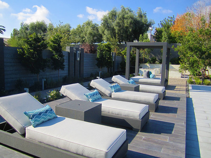 Custom flat adjustable loungers with lumbar pillows on outside deck of las vegas home estate home