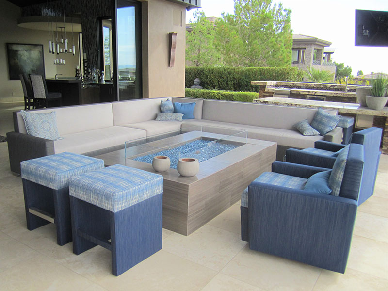 backless cushioned seat and fabric wrapped based barstools add seating to a firepit conversation area