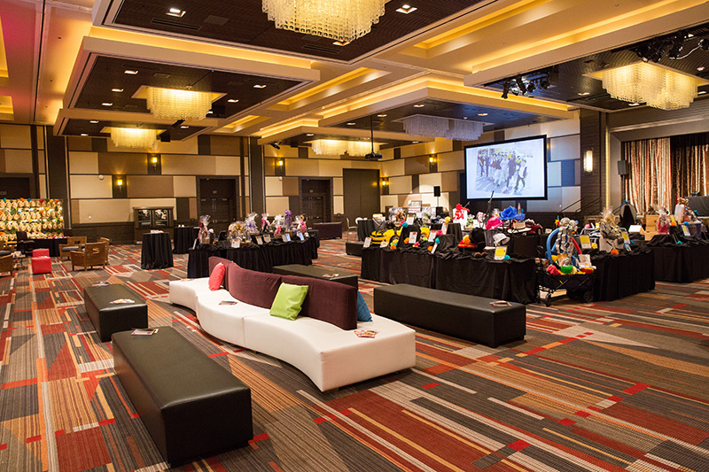 M Resorts meeting room was transformed to a cocktail party with serpentine double sided sectional seating and bright bursts of colored throw pillows