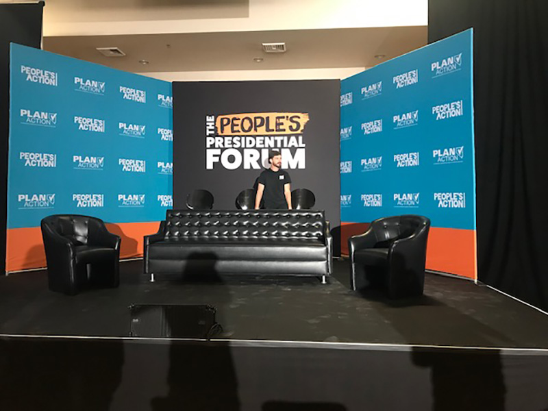 talk show set with Somers Furniture black button sofa and chairs rental furniture