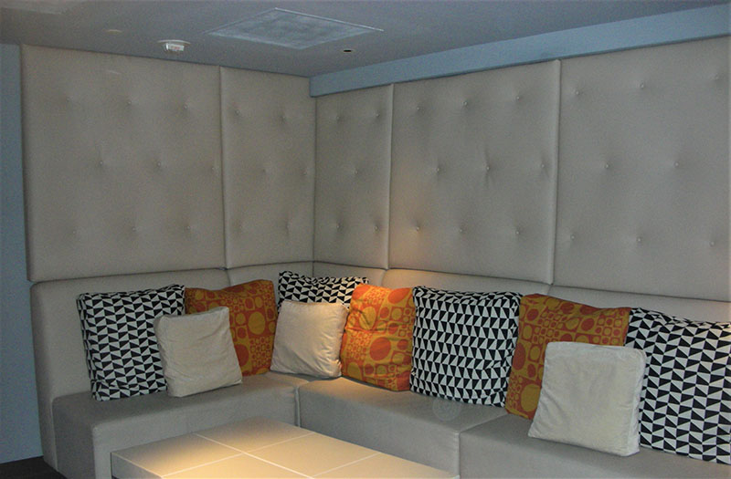 Custom Built Tufted Upholstered acoustic Wall Panels and built-in banquette seating for VIP area of las vegas sportsbook